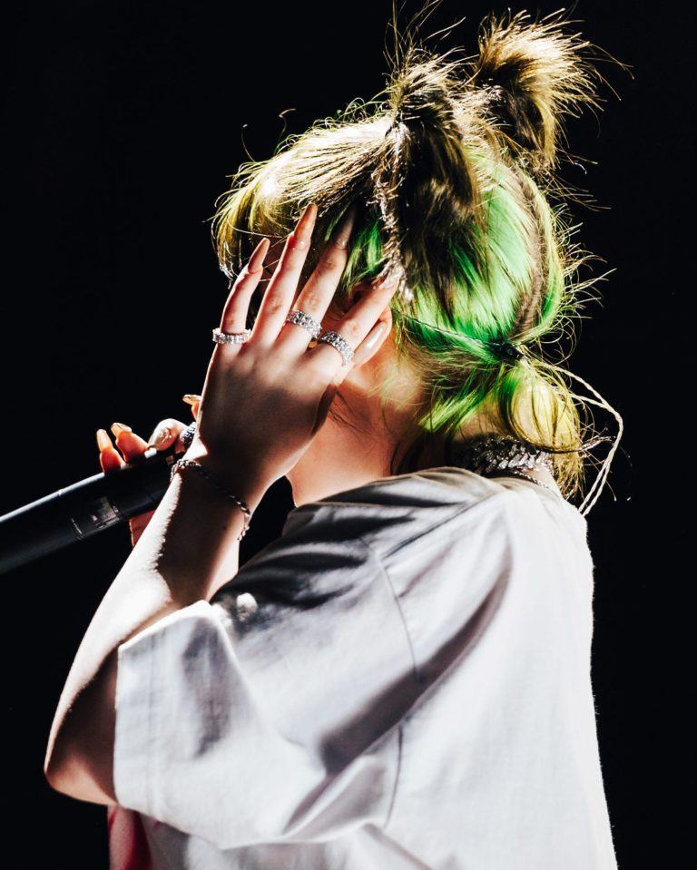 Eilish with a rare broken nail on tour